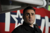 soccer news-fabio cannavaro in black formal jacket in afc champions league