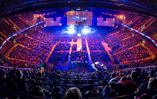 top 5 sports industry trends with image of esports event with fans and players