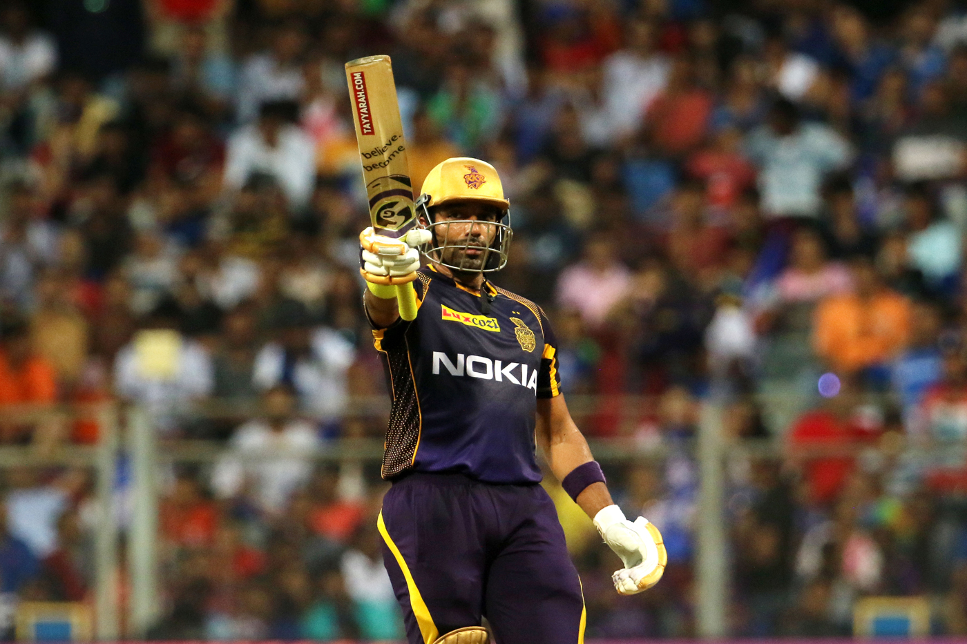 robin uthappa-robin uthappa after scoring 50 in kkr purple jersey