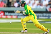t20 world cup 2020-alex carey in yellow australia jersey playing a cricketing shot