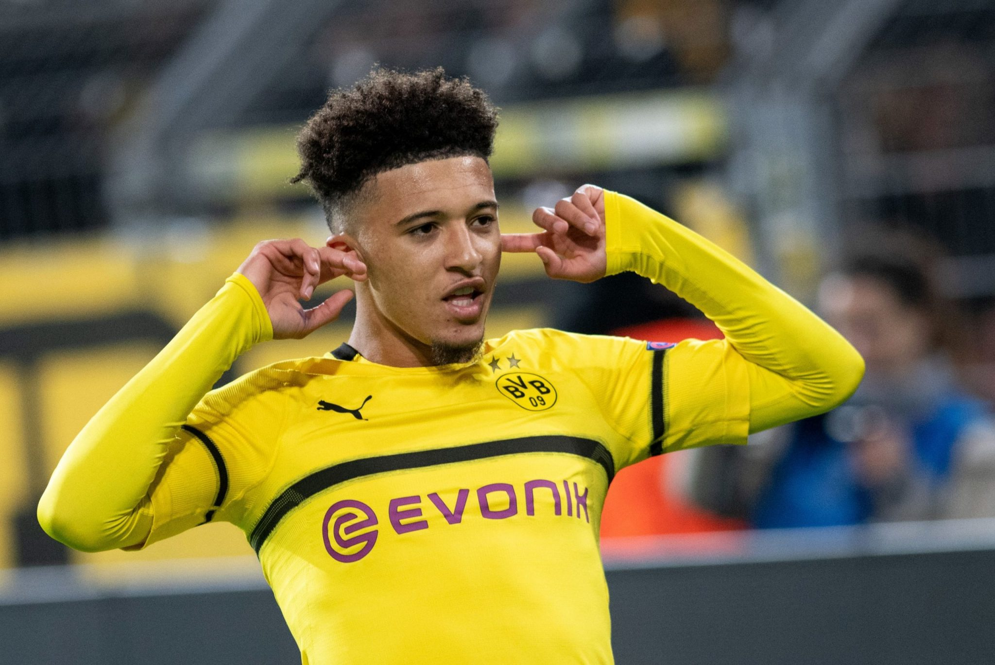 jadon sancho-jadon sancho after celebrating the goal in yellow home jersey of borussia dortmund