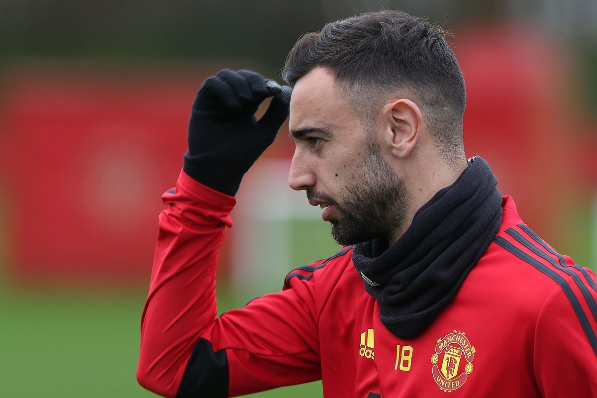 paul scholes-bruno fernandes in practise session in red united kit