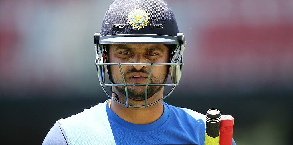 bcci news-suresh raina in blue indian jersey with helmet on head