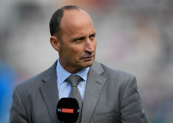nasser hussain cricketer-nasser husain holding mike wearing grey suit