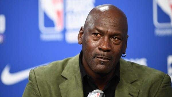 michael jordan team owner-michael jordan in green suit