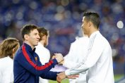 best footballers of all time-messi and ronaldo in their respective jersey