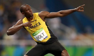 greatest male sprinters of all time- usain bolt in yellow jamaican jersey