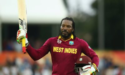 greatest t20 batsmen of all time- chris gayle in west indies jersey holding the bat