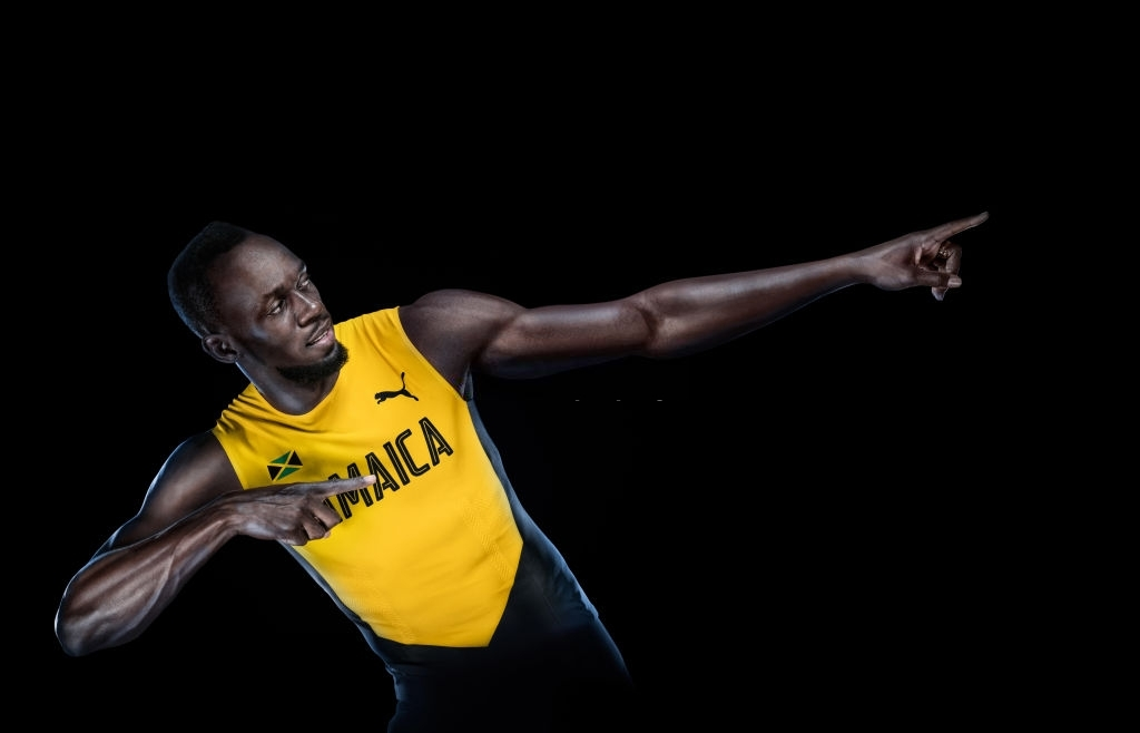 Top 10 athletics world records- usain bolt in yellow jamaica jersey