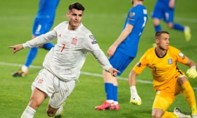 spain vs greece- morata in white spain jersey celebrating after scoring against greece