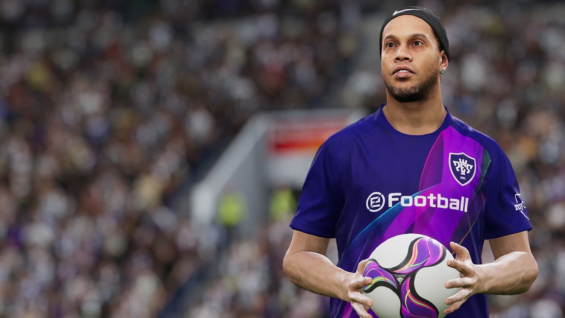 best legends in pes 2021- Ronaldinho holding the ball in PES 21 legend kit