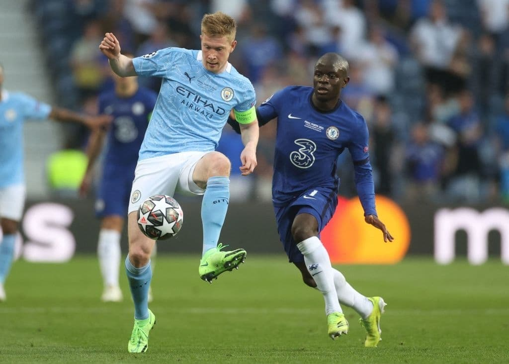 top 10 best midfielders in the world 2021- kevin de bruyne and ngolo kante with football